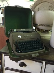 vintage remington typewriter with case