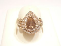 Fancy color diamond with white diamonds teardrop ring