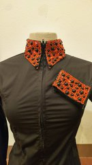 Black zip up shirt with red stones and pearls