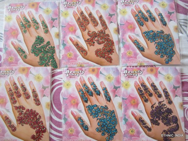 Henna Mehndi Stickers : Ornamental floral elements henna tattoo golden stock illustration