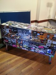 WAREHOUSE MERCH COUNTER on WHEELS / Covered in Band Stickers