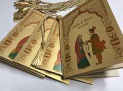Indian Wedding Program Booklet with Indian Bride and Groom with Toran backdrop, decorated with a tassel