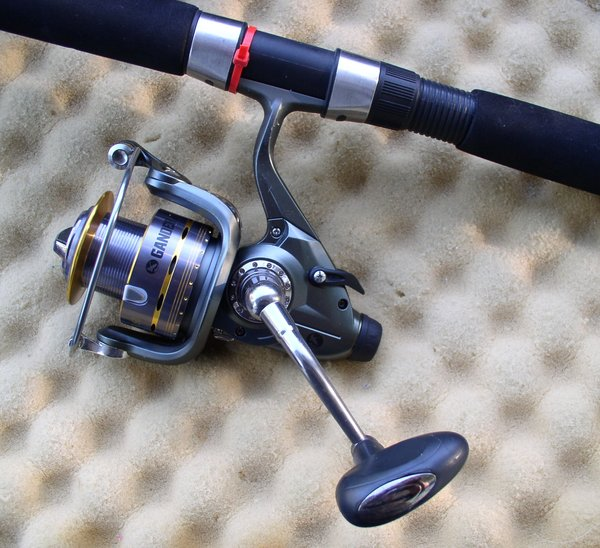 Gander mountain bait feeder series spinning rod real for Gander mountain fishing poles